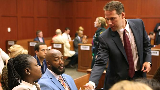 The parents of Trayvon Martin, Sybrina Fulton, left, and Tracy Martin, center, are greeted by assistant state attorney John Guy during the George Zimmerman trial in Seminole circuit court, in Sanford, Fla., Monday, June 24, 2013. Zimmerman has been charged with second-degree murder for the 2012 shooting death of Trayvon Martin. (AP Photo/Orlando Sentinel, Joe Burbank,Pool)