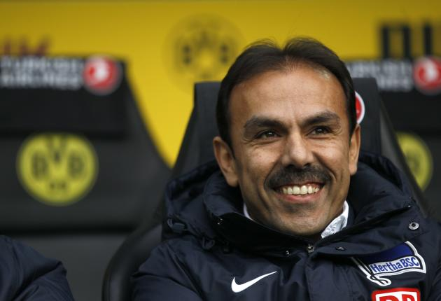 Hertha Berlin's coach Lukukay smiles before the German first division Bundesliga soccer match against Borussia Dortmund in Dortmund