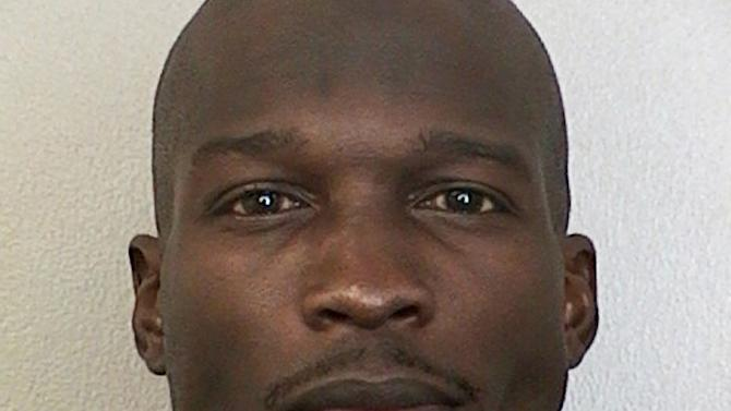 This undated photo provided by the Broward Sheriff's Office shows Miami Dolphins wide receiver Chad Johnson. A judge has set bond at $2,500 for Johnson, who is being held in a Florida jail on a domestic violence charge after his wife accused him of head-butting her during an argument. Johnson's defense attorney, Adam Swickle, says Johnson posted the bond early Sunday, Aug. 12, 2012, though jail records show he had not yet been released. Swickle says a no-contact order has been issued that prevents Johnson from contacting his wife, Evelyn Lozada. (AP Photo/Broward Sheriff's Office)