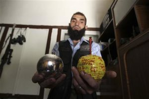 A Free Syrian Army fighter displays homemade bombs made from ornamental balls in the old city of Aleppo