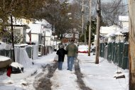 Snow masks much of the damage done to the New Dorp section of Staten Island, N.Y., Thursday, Nov. 8, 2012. The New York-New Jersey region woke up to a layer of wet snow and more power outages after a new storm pushed back efforts to recover from Superstorm Sandy. (AP Photo/Seth Wenig)
