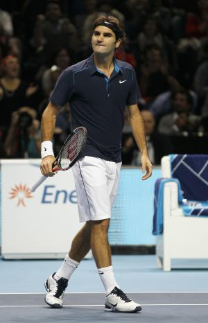 Roger Federer of Switzerland celebrates at match point after beating Rafael Nadal of Spain during their round robin singles tennis match at the ATP World Tour Finals at O2 Arena in London, Tuesday, Nov. 22, 2011.  (AP Photo/Kirsty Wigglesworth)