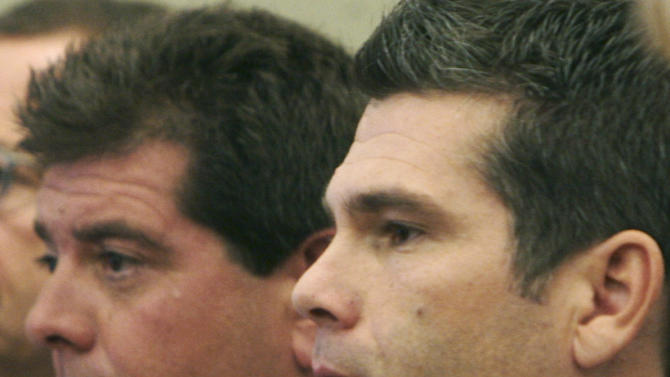 FILE - In this Sept. 29, 2006 file photo, Michael Derderian, left, and brother Jeffrey Derderian stand in Kent County Superior Court in Warwick, R.I.  After they were sentenced for a 2003 fire at their West Warwick nightclub that killed 100 people, the Derderian brothers set up a charity to help educate dozens of children who lost a parent in the blaze. Despite claims, the charity has given only modest help to the children. (AP Photo/Bob Breidenbach, Pool, File)