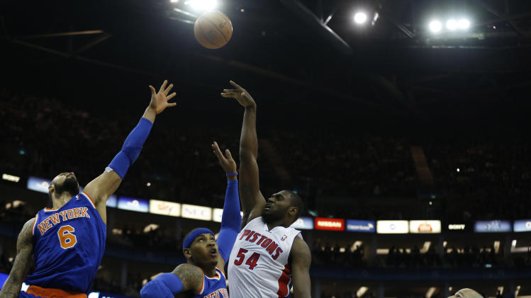 Detroit Pistons forward Jason Maxiell, 54, shoots past New York Knicks center Tyson Chandler, 6, forward Carmelo Anthony, second left, and guard Jason Kidd, right, during their NBA basketball game at the 02 arena in London, Thursday, Jan. 17, 2013.  (AP Photo/Matt Dunham)