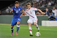 Italy's Nocerino (L) fights for the ball with Russia's Kombarov during their friendly football match in Zurich. Russia won 3-0