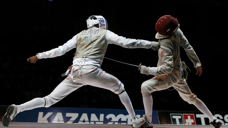 Lefort of France competes against Chen of China in the men's team foil final match at the World Fencing Championships in Kazan