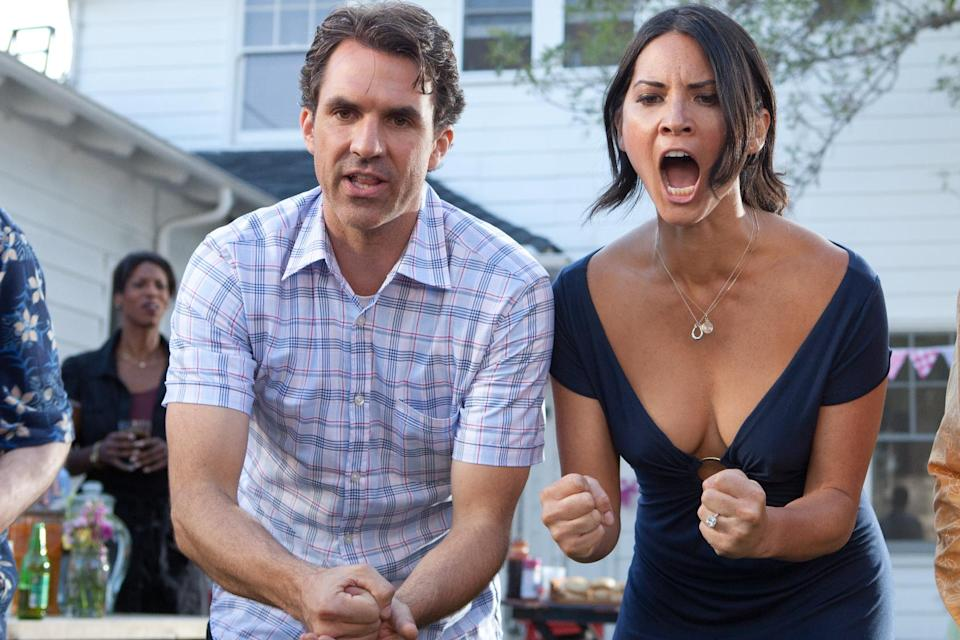 "This film image released by Millennium Films shows Paul Schneider, left, and Olivia Munn in a scene from ""The Babymakers."" (AP Photo/Millennium Films, Dan McFadden)"