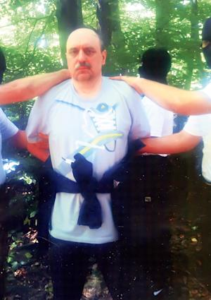 In this photo provided by the Politika newspaper shows war crimes fugitive Goran Hadzic on Mt. Fruska Gora, Serbia Wednesday July 20, 2011. Serbian authorities tracked down war crimes fugitive Goran Hadzic in the northern mountains Wednesday arresting the last remaining fugitive sought by the U.N. war crimes court after eight years on the run.(AP Photo/Politika newspaper, HO) EDITORIAL USE ONLY