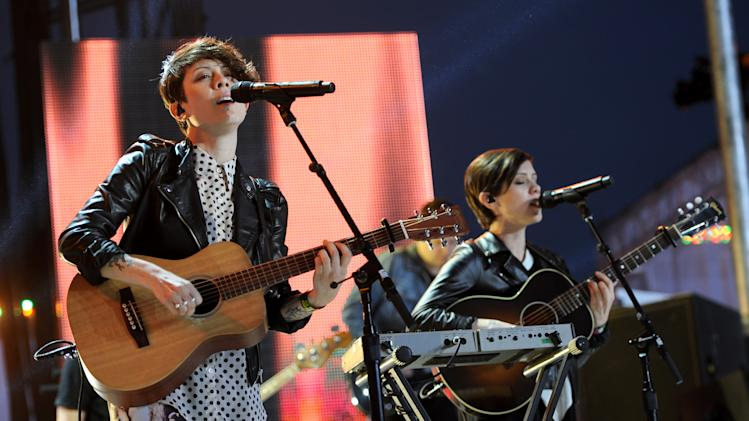 IMAGE DISTRIBUTED FOR MTV - Tegan Quin, left, and Sara Quin, of musical group Tegan and Sara, perform at the mtvU Woodie Awards on Thursday, March 14, 2013, in Austin, Texas. (Photo by Scott Gries/Invision for MTV/AP Images)