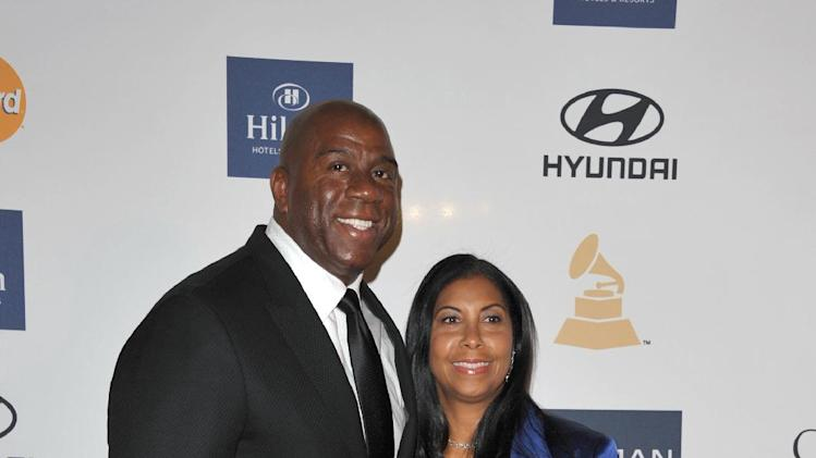 Former NBA basketball player Magic Johnson, left, and Earlitha Kelly arrive at the Clive Davis Pre-GRAMMY Gala on Saturday, Feb. 9, 2013 in Beverly Hills, Calif. (Photo by John Shearer/Invision/AP)