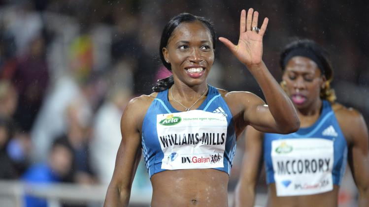 Jamaica's Novlene Williams-Mills wins the women's 400 metres event during the IAAF Diamond League at the Stockholm Olympic Stadium