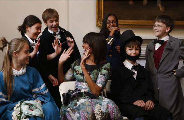 U.S. first lady Obama reacts with school children from Willow Springs Elementary School in Fairfax, Virginia