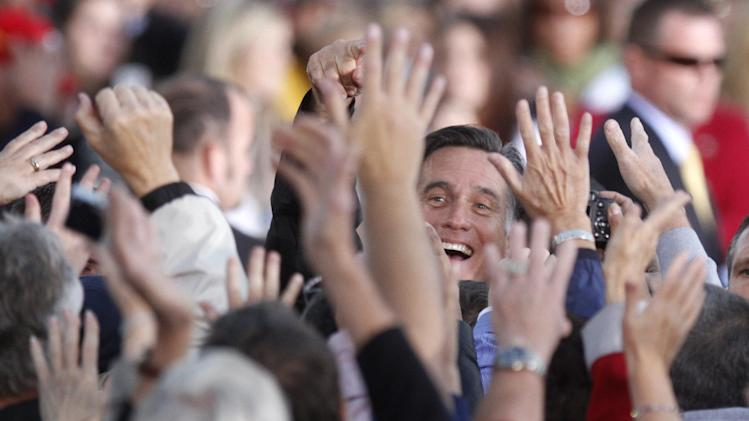 Republican presidential candidate, former Massachusetts Gov. Mitt Romney greets supporters during a campaign rally in Lancaster, Ohio,  Friday, Oct. 12, 2012. (AP Photo/Paul Vernon)
