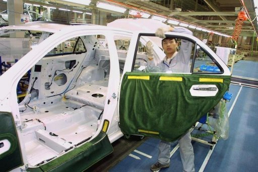 &lt;p&gt;This file photo shows a worker installing parts to a Toyota vehicle at a factory in Tianjin. Toyota Motor is cutting its target of producing more than 10 million vehicles this year after suffering a sales drop in key market China amid strained Sino-Japanese ties, a report said on Tuesday.&lt;/p&gt;