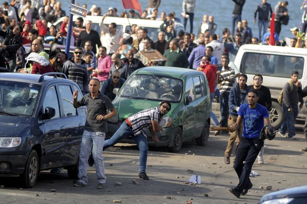 Protesters hurl st&#111;nes during clashes between supporters and opp&#111;nents of President Mohammed Morsi in Alexandria, Egypt, Friday, Nov. 23, 2012. Opp&#111;nents and supporters of Mohammed Morsi clashed across Egypt &#111;n Friday, the day after the president granted himself sweeping new powers that critics fear can allow him to be a virtual dictator. Thousands from the two camps threw st&#111;nes and chunks of marble at each other outside a mosque in the Mediterranean city of Alexandria after Friday Muslim prayers. (AP Photo/Tarek Fawzy)
