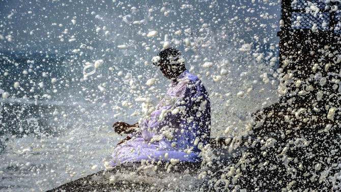 A man sits at the beach in Karachi, Pakistan, October 28, 2014. A tropical cyclone named Nilofar was heading for western India from over the Arabian Sea.(EPA/SHAHZAIB AKBER)