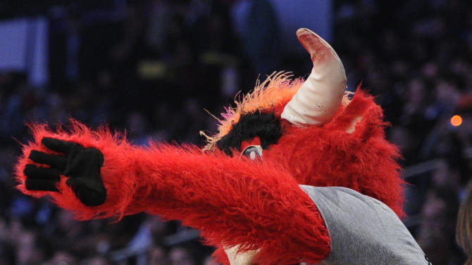 The Chicago Bulls mascot jokes around with Justin Bieber during the first half of the NBA basketball All-Star Game on Sunday, Feb. 20, 2011, in Los Angeles. (AP Photo/Mark J. Terrill)