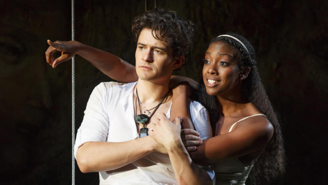 """This theater image released by The Hartman Group shows Orlando Bloom, left, and Condola Rashad during a performance of """"Romeo and Juliet,"""" in New York. Content provider Screenvision and the new company BroadwayHD have teamed up to broadcast the recent Orlando Bloom-led production of """"Romeo and Juliet"""" to movie theaters across the country. It marked the first time in over 36 years """"Romeo and Juliet"""" had been on Broadway. (AP Photo/The Hartman Group, Carol Rosegg)"""