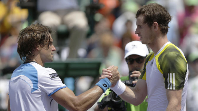 CORRECTS SCORE - Andy Murray, of Great Britain, right, shakes hands with David Ferrer, of Spain, after winning the final of the Sony Open tennis tournament Sunday  March 31, 2013, in Key Biscayne, Fla. Murray won 2-6, 6-4, 7-6 (1). (AP Photo/Wilfredo Lee)