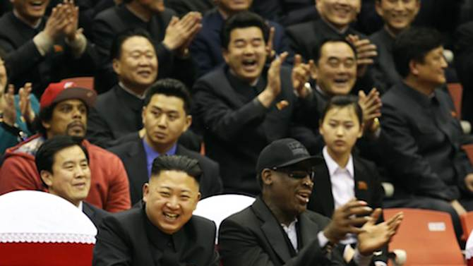 """This undated publicity image released by HBO shows former NBA basketball player Dennis Rodman, right, with North Korea's Kim Jong Un at a basketball game from an episode of the documentary series """"Vice.""""  The season final episode will air on on June 14 at 11 p.m. EST on HBO. (AP Photo/Vice.com via HBO)"""
