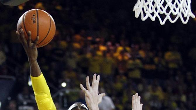 Michigan guard Tim Hardaway Jr. (10) takes a shot against Indiana forward Cody Zeller (40) during the second half of an NCAA college basketball game Sunday, March 10, 2013, in Ann Arbor, Mich. Indiana defeated Michigan 72-71 to win the Big Ten title. (AP Photo/Duane Burleson)