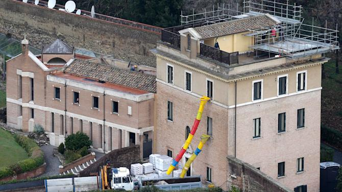 A view of the Mater Ecclesiae Monastery inside the Vatican State where Pope Benedict XVI is expected to live after he resigns, on Tuesday, Feb. 12, 2013. For months, construction crews have been renovating a four-story building attached to a monastery on the northern edge of the Vatican gardens where nuns would live for a few years at a time in cloister. Only a handful of Vatican officials knew it would one day be Pope Benedict XVI's retirement home. On Tuesday, construction materials littered the front lawn of the house and plastic tubing snaked down from the top floor to a dump truck as the restoration deadline became ever more critical following Benedict's stunning announcement that he would resign Feb. 28 and live his remaining days in prayer. (AP Photo/Alessandra Tarantino)