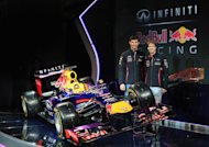 MILTON KEYENES, ENGLAND - FEBRUARY 03:  Drivers Mark Webber of Australia (L) and Sebastian Vettel of Germany pose along side the new car during the Infiniti Red Bull Racing RB9 launch on February 3, 2013 in Milton Keyenes, England.  (Photo by Richard Heathcote/Getty Images)