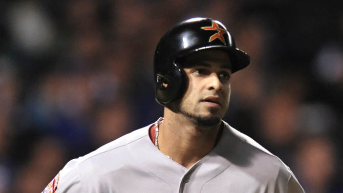 Houston Astros' Fernando Martinez watches his solo home run in the second inning during a baseball game against the Chicago Cubs in Chicago, Monday, Oct. 1, 2012. (AP Photo/Paul Beaty)