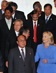 U.S. Secretary of State Hillary Rodham Clinton, in blue, talks with Japanese Foreign Minister Takeaki Matsumoto, center, as North Korean Foreign Minister Pak Ui Chun, bottom, South Korean counterpart Kim Sung-hwan, behind Matsumoto, and other foreign ministers walk by them prior to the start of ASEAN Regional Forum in Nusa Dua, Bali, Indonesia, Saturday, July 23, 2011. Clinton is telling North Korea that it must do more to improve ties with the South before the U.S. and other countries will return to nuclear disarmament talks. (AP Photo/Saul Loeb, Pool)