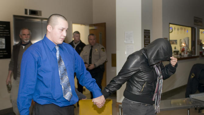 J.T. Papequash and Naneek Graham, the children of John Graham, leave the Pennington County Courthouse of Friday, Dec. 10, 2010, after their father was found guilty of felony murder involving a kidnapping, in connection with the 1975 slaying of Annie Mae Aquash, in 7th Circuit Court in Rapid City, SD. Graham was found not guilty of premeditated murder in the trial. (AP Photo/Steve McEnroe)