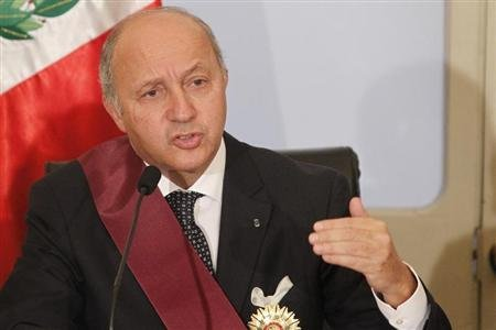 France's Foreign Minister Laurent Fabius speaks to the media next to his Peruvian counterpart Rafael Roncagliolo (not pictured) after the signing of bilateral agreements at a meeting in Lima February 21, 2013. REUTERS/Enrique Castro-Mendivil