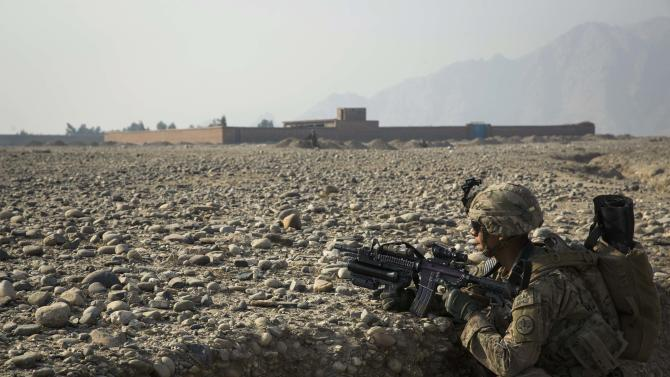 A U.S. soldier from the 3rd Cavalry Regiment provides security during an advising mission to an Afghan police station constructed by ISAF near Jalalabad