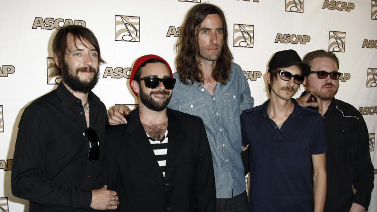 FILE - This April 27, 2011 file photo shows members of the Band of Horses, from left, Ben Bridwell, Creighton Barrett, Tyler Ramsey, Bill Reynolds and Ryan Monroe, arrives at the 28th Annual ASCAP Pop Music Awards in Los Angeles. (AP Photo/Matt Sayles, file)