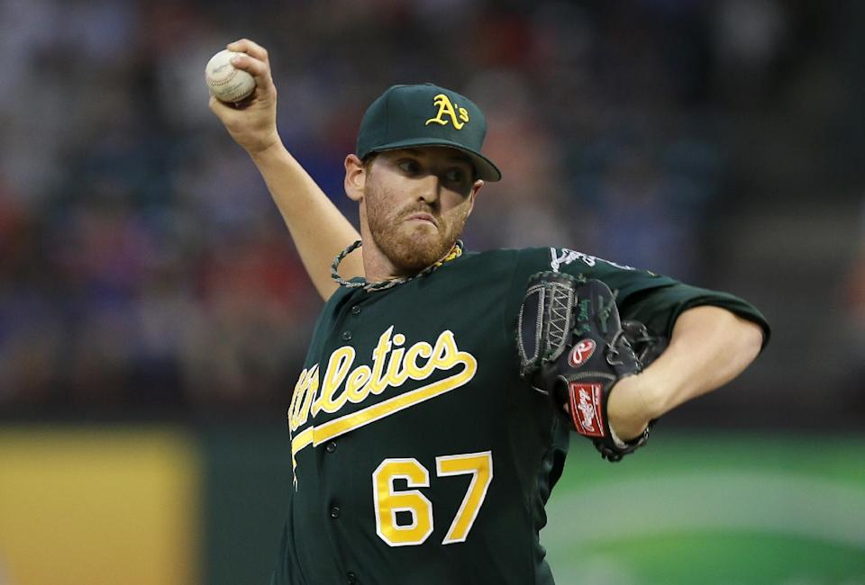 Oakland Athletics starting pitcher Dan Straily (67) works against the Texas Rangers in the first inning of a baseball game, Friday, Sept. 13, 2013, in Arlington, Texas. (AP Photo/Tony Gutierrez)