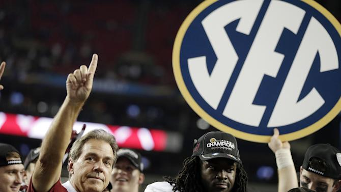 Alabama head coach Nick Saban and running back Eddie Lacy after their 32-28 win in the Southeastern Conference championship NCAA college footballgame against Georgia, Saturday, Dec. 1, 2012, in Atlanta. (AP Photo/David Goldman)