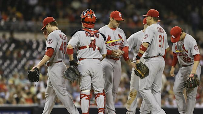 St. Louis Cardinals starting pitcher Shelby Miller, left, leaves the mound after being relieved by manger Mike Matheny in the sixth inning after throwing 107 pitches against the San Diego Padres in a baseball game in San Diego, Monday, May 20, 2013. Miller left with the lead but the Cardinals bullpen allowed two runs in the sixth inning to surrender the lead. (AP Photo/Lenny Ignelzi)