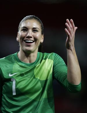United States goalkeeper Hope Solo reacts after her team's semfinal 4-3 win over Canada in the women's soccer match at the 2012 London Summer Olympics, Monday, Aug. 6, 2012 at Old Trafford Stadium in Manchester, England. (AP Photo/Jon Super)