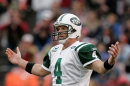 FILE - In this Dec. 7, 2008, file photo, New York Jets quarterback Brett Favre reacts to a missed pass during the second half on an NFL football game against the San Fransisco 49ers in San Francisco. A lawsuit filed by two massage therapists who sued retired NFL quarterback Brett Favre over claims he sent racy text messages has been settled, a lawyer for the women said Friday, May 24, 2013. (AP Photo/Marcio Jose Sanchez, File)