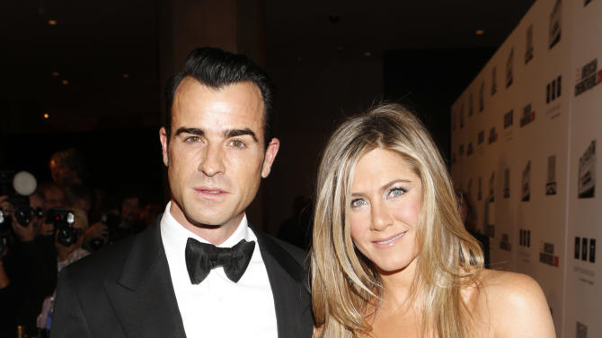 Justin Theroux and Jennifer Aniston attend the American Cinematheque 26th Annual Award Presentation To Ben Stiller 2012 at The Beverly Hilton Hotel on Thursday November 15, 2012 in Beverly Hills, California.  (Photo by Todd Williamson/Invision/AP Images)