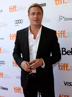 "Brad Pitt arrives at the premiere for ""12 Years a Slave"" on day 2 of the Toronto International Film Festival at The Princess of Wales Theatre on Friday, Sept. 6, 2013, in Toronto. (Photo by Chris Pizzelloi/Invision/AP)"
