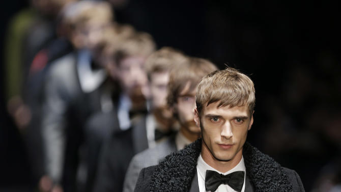 Models wear creations for Gucci men's Fall-Winter 2013-14 collection, part of the Milan Fashion Week, unveiled in Milan, Italy, Monday, Jan. 14, 2013. (AP Photo/Antonio Calanni)