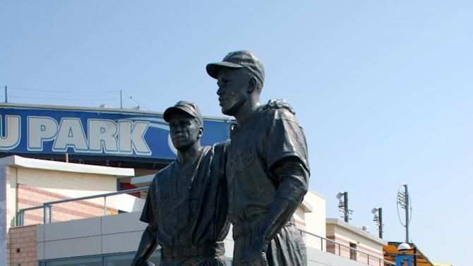 """This undated image provided by the Brooklyn Cyclones shows a statue of Pee Wee Reese and Jackie Robinson at MCU Park in the Coney Island section of the Brooklyn borough of New York, where the minor league Cyclones team plays. A new film, """"42,"""" tells the inspiring story of how Robinson integrated Major League Baseball when he played for the Brooklyn Dodgers. The pedestal of the statue states that Reese, captain of the Dodgers, """"stood by Jackie Robinson against prejudiced fans and fellow players"""" by walking over to Robinson, standing next to him and """"silencing the taunts of the crowd""""  during a game in Cincinnati. (AP Photo/Brooklyn Cyclones)"""