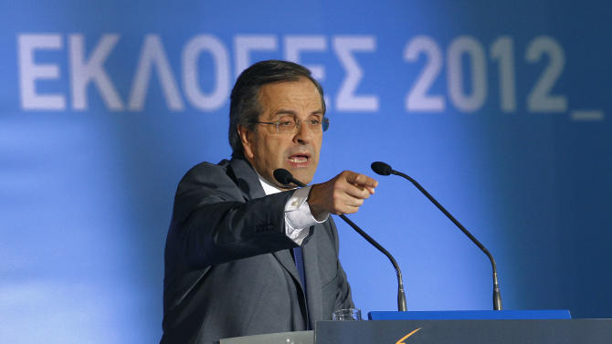 Leader of the conservative New Democracy party Antonis Samaras speaks to his supporters during an election rally at Syntagma square in Athens, Friday, June 15, 2012. Greeks cast their ballots this Sunday for the second time in six weeks, after May 6 elections left no party with enough seats in Parliament to form a government and coalition talks collapsed. (AP Photo/Petros Karadjias)