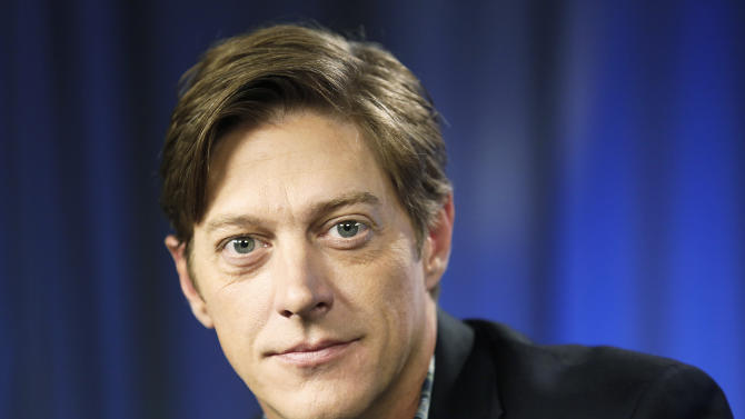 """This June 11, 2013 photo shows actor Kevin Rahm, who portrays Ted Chaough on the television series """"Mad Men,"""" in Los Angeles. Rahm's character appeared in a handful episodes in past seasons as the boss of a competing advertising firm. But the recent merger of his and Don Draper's companies _ along with a shocking kiss with Peggy Olson (Elisabeth Moss) _ has thrust Ted to the forefront of the 1960s ad world drama.  (AP Photo/Reed Saxon)"""