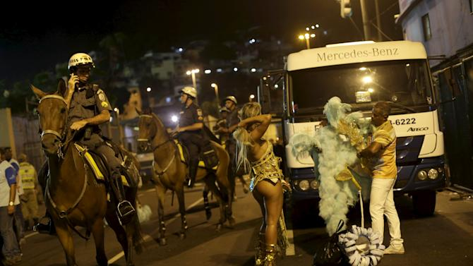 Revellers of the Estacio de Sa samba school leave the Sambadrome after parading in the carnival in Rio de Janeiro