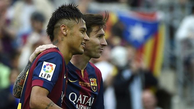 Barcelona forwards Lionel Messi (R) and Neymar celebrate a goal during the Spanish league football match against Deportivo La Coruna at the Camp Nou stadium in Barcelona on May 23, 2015