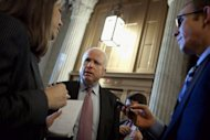 <p>Republican Senator John McCain talks with reporters before heading into the Senate chamber to vote, on February 14, 2013. Republicans ignored a White House demand for a vote to confirm President Barack Obama's pick for defense chief, throwing up a roadblock at a time of rising national security tensions.</p>
