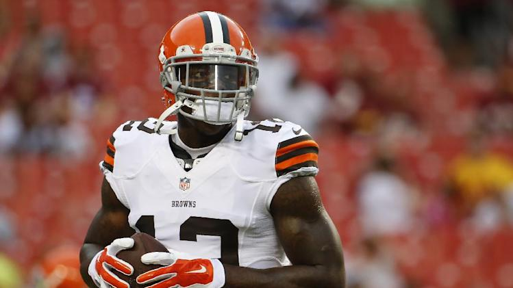 In this Aug. 18, 2014, file photo, Cleveland Browns wide receiver Josh Gordon (12) warms up before an NFL preseason football game against the Washington Redskins in Landover, Md. Gordon has been suspended by the NFL one year for violating the league's substance abuse policy. Gordon's suspension is effective immediately and he will miss the entire 2014 season
