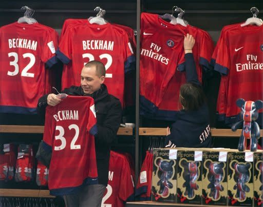 For Beckham in Paris, flashbulbs burn differently