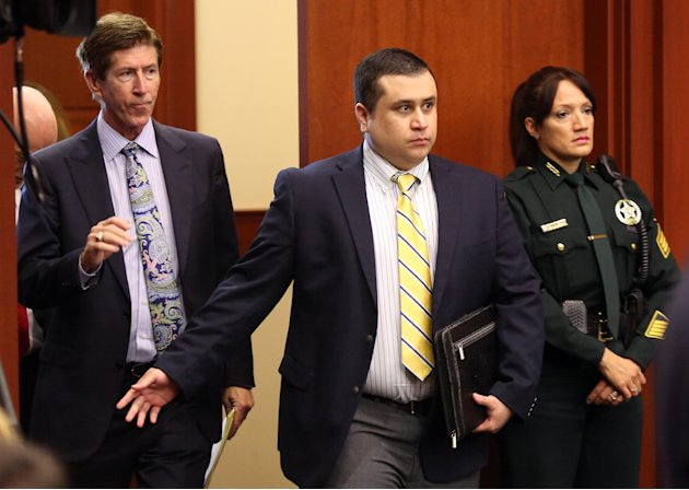 George Zimmerman, defendant in the killing of Trayvon Martin, arrives in Seminole circuit court, in Sanford, Fla., with his attorney Mark O'Mara, left, for a pre-trial hearing, Tuesday, April 30, 2013